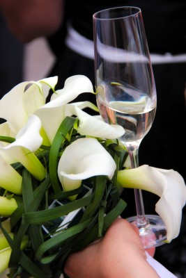 bouquet and champagne glass 13881370_s