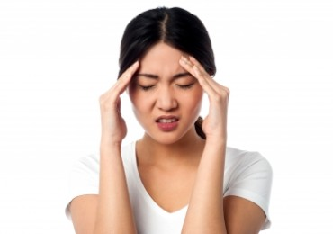 Young Woman Having Headache