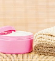 Cream In Pink Cup With Towels